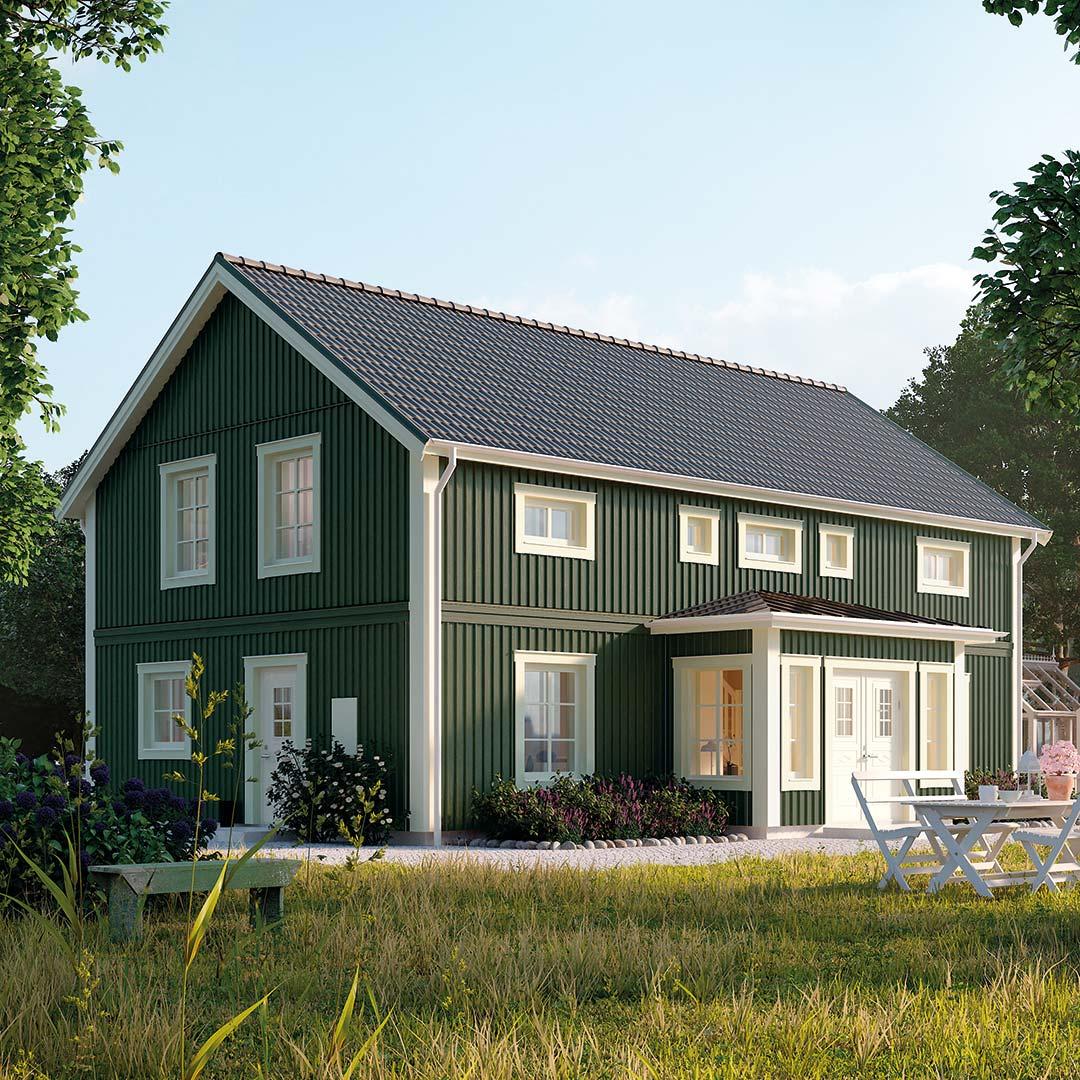 Klassisk hus malt i grønn farge persille