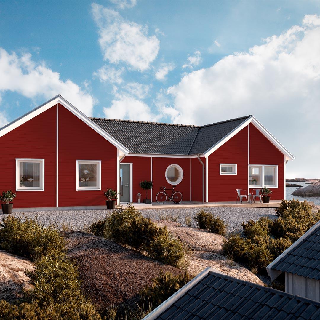 Hus ved sjøen malt med rød farge paprika